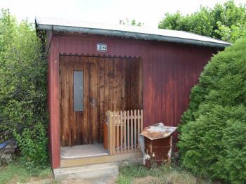 Chata na pozemku - Prodej pozemku 1119 m², Vochov