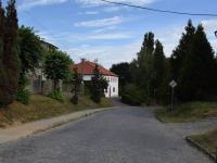 Pohled směrem od pozemku - Prodej pozemku 1119 m², Vochov