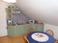 kuchyň 1.patro (Prodej domu v osobním vlastnictví 322 m², Jesenice)