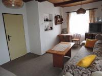obývací pokoj (Prodej domu v osobním vlastnictví 90 m², Břežany)