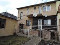 pohled na dům ze zahrady (Prodej domu v osobním vlastnictví 186 m², Kladno)