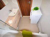 Koupelna - Prodej bytu 3+kk v osobním vlastnictví 68 m², Slaný