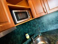 Detail kuchyňské linky - Prodej bytu 2+1 v osobním vlastnictví 52 m², Kladno