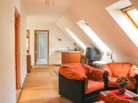 obývací pokoj v podkroví - Prodej domu v osobním vlastnictví 168 m², Kněževes