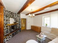 pokoj s krbem - přízemí - Prodej domu v osobním vlastnictví 415 m², Děčín