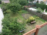 Pohled z terasy na zahradu - Prodej domu v osobním vlastnictví 160 m², Chomutov