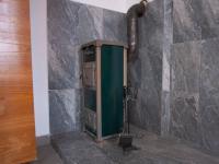 apartmán přízemí - kamna   - Prodej domu v osobním vlastnictví 400 m², Vejprty
