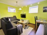 Obývací pokoj s kuchyňským koutem (Prodej bytu 3+kk v osobním vlastnictví 72 m², Praha 5 - Motol)