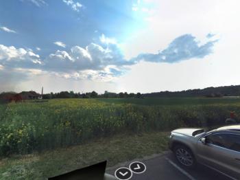 Letní foto - Prodej pozemku 13942 m², Žatec