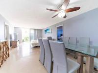 obývací pokoj s jídelním stolem - Prodej bytu 3+kk v osobním vlastnictví 121 m², Fort Lauerdale