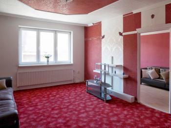 Obývací pokoj 1.NP - Prodej domu v osobním vlastnictví 205 m², Blučina