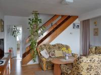 Obývací pokoj 1.NP (Prodej domu v osobním vlastnictví 210 m², Mikulov)