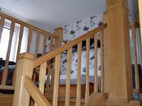 Schodiště do 1.patra - Pronájem bytu 2+kk v osobním vlastnictví 38 m², Drnovice