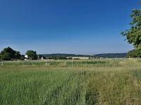 Výhled z pozemeku - západní směr - Prodej pozemku 1340 m², Habrůvka