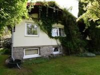 pohled na dům ze zadní části zahrady - Prodej domu v osobním vlastnictví 105 m², Louňovice