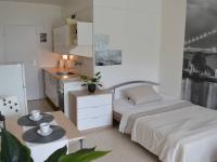 Prostor i pro jídelní stůl - Prodej bytu 1+kk v osobním vlastnictví 30 m², Brno
