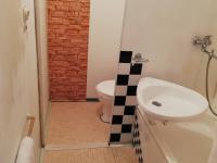 Koupelna s WC - Prodej bytu 1+kk v osobním vlastnictví 30 m², Brno