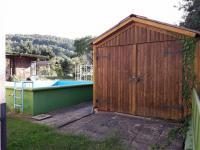 garáž v zahradě (Prodej domu v osobním vlastnictví 250 m², Dolní Studénky)