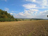 Prodej pozemku 35627 m², Drahlín