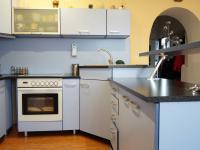 podkroví - kuchyňský kout (Prodej domu v osobním vlastnictví 218 m², Praha 6 - Břevnov)
