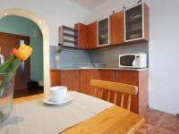 1. podlaží - kuchyňský kout  (Prodej domu v osobním vlastnictví 218 m², Praha 6 - Břevnov)