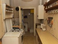 kuchyně s průchodem do koupelny - Prodej bytu 2+1 v osobním vlastnictví 101 m², Praha 5 - Smíchov