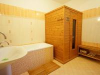 koupelna se saunou 1. NP - Prodej domu v osobním vlastnictví 220 m², Praha 10 - Kolovraty