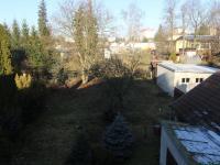 Pohled na zahradu ze schodiště (Prodej bytu 3+1 v osobním vlastnictví 174 m², Svitavy)