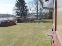výhled do okolí z terasy (Prodej bytu 4+kk v osobním vlastnictví 83 m², Velké Popovice)