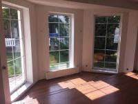 Obývací místnost 1NP (Prodej domu v osobním vlastnictví 351 m², Praha 9 - Klánovice)
