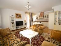 Obytná místnost - Prodej bytu 3+kk v osobním vlastnictví 80 m², Mariánské Lázně