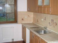Kuchyň. - Prodej domu v osobním vlastnictví 196 m², Trubská
