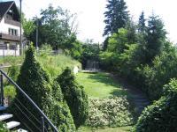 Okolí před domem. - Prodej domu v osobním vlastnictví 356 m², Beroun