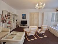 Obývací pokoj bytu A (Prodej domu 600 m², Tábor)