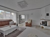 obývací pokoj s krbovými kamny - Prodej domu v osobním vlastnictví 308 m², Zbůch