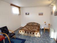pokoj 1.NP (Prodej nájemního domu 560 m², Chroboly)