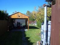 Garážové stání (Prodej domu v osobním vlastnictví 85 m², Zlukov)