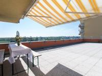 Terasa a výhled na východ na lesopark - Prodej bytu 3+kk v osobním vlastnictví 94 m², Praha 9 - Letňany
