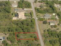 Pohled na parcelu (Prodej pozemku 2018 m², Lehigh Acres)