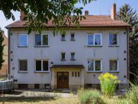 Pohled na dům zezadu (Prodej bytu 3+kk v osobním vlastnictví 79 m², Rosice)
