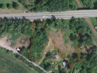 Druhá část pozemku - Prodej pozemku 3220 m², Dvorce