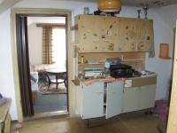 kuchyň v 2.NP (Prodej domu v osobním vlastnictví 80 m², Supíkovice)