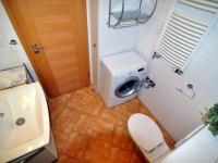 prostor pro pračku a topný žebřík - Prodej bytu 2+kk v osobním vlastnictví 61 m², Praha 5 - Zbraslav