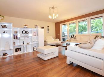 Obývací pokoj - Prodej bytu 3+kk v osobním vlastnictví 124 m², Praha 5 - Stodůlky