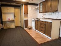 kuchyňský kout v pokoji v podkroví (Prodej chaty / chalupy 290 m², Slunečná)