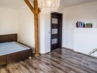 ložnice v podkroví (Prodej domu v osobním vlastnictví 218 m², Doksy)