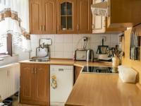 kuchyň jednoho z bytů - Prodej nájemního domu 275 m², Česká Lípa