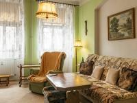 obývací pokoj jednoho z bytů - Prodej nájemního domu 275 m², Česká Lípa