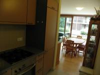 pohled z kuchyně do obýváku (Prodej bytu 5+kk v osobním vlastnictví 108 m², Praha 6 - Bubeneč)