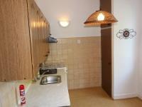 Kuchyň 2 foto (Prodej bytu 2+1 v osobním vlastnictví 54 m², Praha 3 - Žižkov)